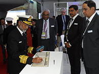 VICE ADMIRAL N N KUMAR, CHIEF OF MATERIAL SIGNING THE VISITORS' BOOK