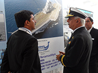 REAR ADMIRAL G S PUBBY, DIRECTOR GENERAL P75, BEING EXPLAINED YEOMAN'S PLANS FOR INS VIKRAMADITYA